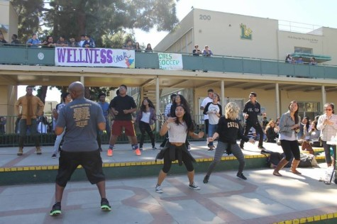 Girls Basketball Head Coach Carl Buggs leads a Zumba session of Poly students during Wednesday at lunch.