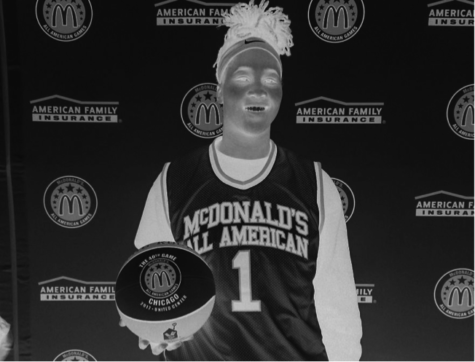 Ayanna Clark poses for a picture with the Mcdonald's All-American jersey and basketball.