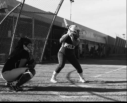Junior Evelyn Sablan batting before she scores a home run.