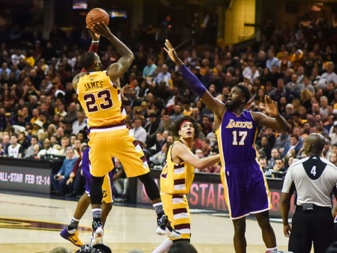 Lebron (23 and pictured in his Cleveland uniform) used to dominate against the Lakers - this year he's switching teams and working with the Lakers young talent. Also pictured is retired basketball player Roy Hibbert, Lakers #17.