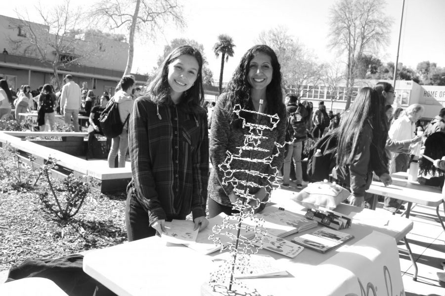 On February 6th, Poly held their annual Elective Faire during lunch in the quad. Here, elective classes set up tables and encourage students walking by to sign up for their class to prepare for next year. To attract students to their tables, some classes display models and have fliers that show a little bit of what the class looks like. For example, the Poly Drama Club is showing how much fun their class is through inviting people to hula hoop. Some other elective options shown here include AVID, Yearbook, Newspaper, and Beach Club.