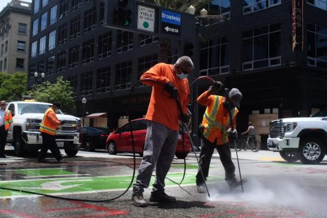 City workers clean up graffiti after protests in June